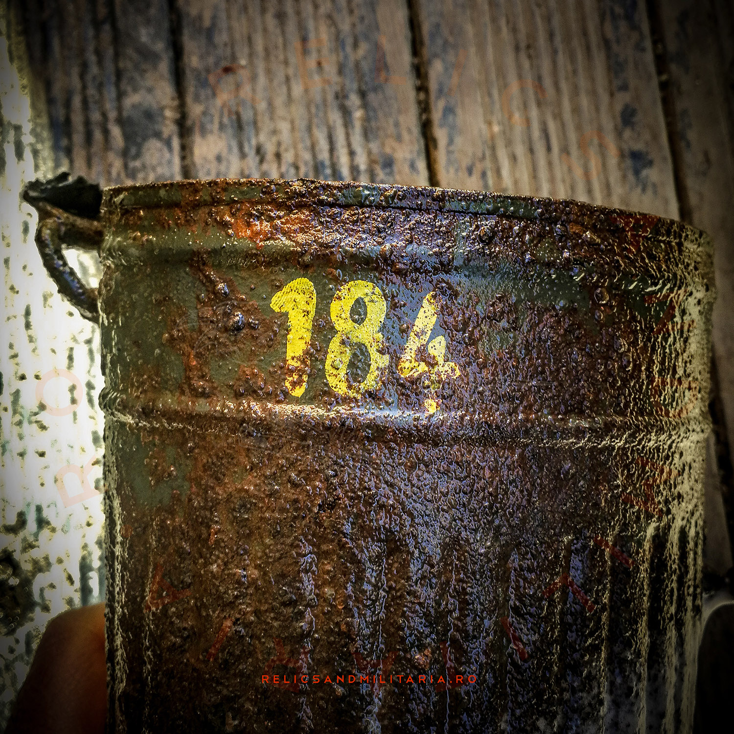 Wehrmacht gas mask canister with soldier's name written on it with paint